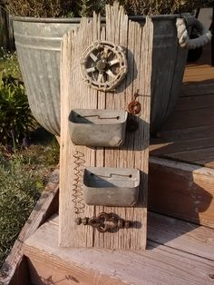 Wall hanging ~salvaged fenceboard, bins, rusty springs, valve....by Rusty Junque