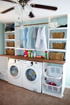 Laundry room organization. Like the angled support for laundry baskets. like to rod between the cabinets