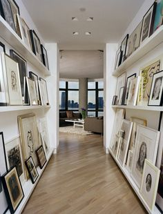 totally loving the idea of a gallery in a hallway or entryway