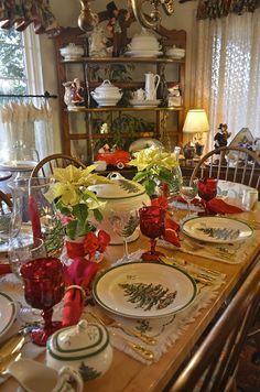Spode christmas tree china, red goblets and centerpieces make a festive Christmas tablescape!!! Bebe'!!!