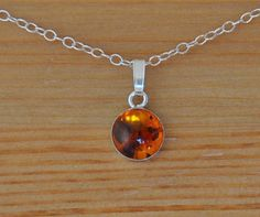 Amber Pendant handmade with a Sterling Silver setting and dainty silver necklace. Look fabulous in this radiant Amber and Sterling Silver pendant fabricated in my studio using traditional silversmith techniques. Handmade Amber 8 mm cabochon with sterling silver setting and chain.