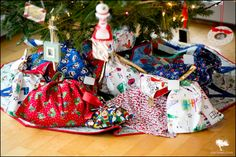 A tutorial for making DIY Holiday Gift Bags - a great present and a beautiful addition to under the tree!
