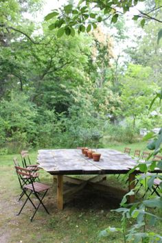 my outdoor dining table on long island, designed by the hardin boys...enuf room for centerpiece to not be in the way of place settings & while eating!