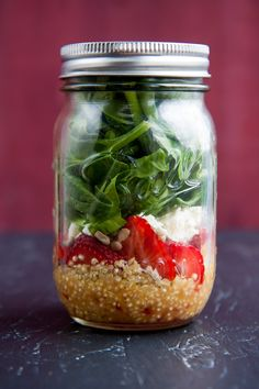 strawberry spinach salad in a jar.  Got the salad in a jar idea from a friend who makes them for taking lunches to work.  Such a great idea!!  Can't wait to try this one!