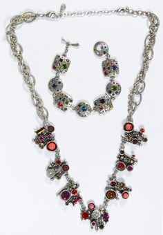 Lot 571: Patricia Locke Silvertone Necklace; Having various red-tone crystals; together with a similar bracelet having multi-color crystals