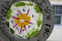 "Flower Mandala Suncatcher using a paper plate from The Artful Parent ("",)"