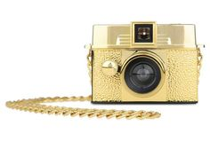 Diana Baby Lens Kit w/ Chain, Gold - Dressed in a flashy golden coat, the Diana Baby 110 Gold Edition is a great introduction to the world of 110 photography. This tiny camera easily slides into your pocket and comes with a 24mm lens, perfect for capturing memories.