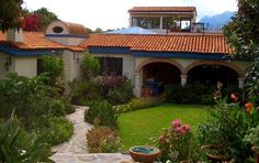 Red tile roof, cream walls, blue accents