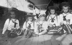OTMAA with a litter of kittens onboard the Standart, 1908... Funny, they don't look very happy!