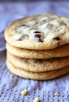 These are the best Chewy Chocolate Chip Cookies you will EVER make!! So easy and with a simple trick for perfect cookies every time! www.thebusybaker.ca