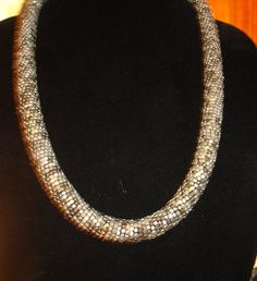 Gunmetal Coil 32 inch tube necklace. Starting at $10