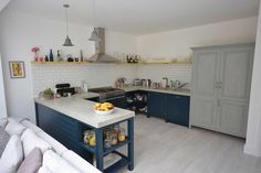 Overview of bespoke kitchen showing polished concrete worktops freestanding fridge freezer and larder Concrete Worktop Kitchen, Freestanding Fridge, Farrow And Ball Paint, Bespoke Kitchens, Larder, Polished Concrete, Work Tops, Countertops, Freezer