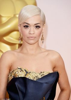 Regal: Rita wore thick flicks of eyeliner and nude lipstick and accessorised with ornate g...