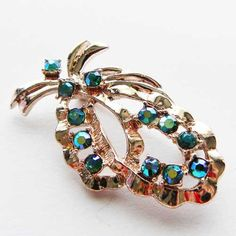 Sparkling crystal in this aurora borealis diamante brooch with blue shimmers and a hint of turquoise An elegant shape to this seventies crystal jewellery