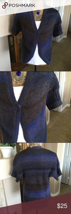 "🆕 Listing Chico's Short Sleeve Ombré Sweater Cute cardigan that is great to layer long sleeve tops under! The knit has an ombré effect in shades of Browns and Blues. There is a single snap closure. The bust measures approx 40"" and the length 25"". This is a Chico's size 0 designed to fit size 4/6 or XS. Please see size chart towards the top of my closet. 52% wool and 48% Acrylic. I wore this a few times, but it is in like new condition! Chico's Sweaters"
