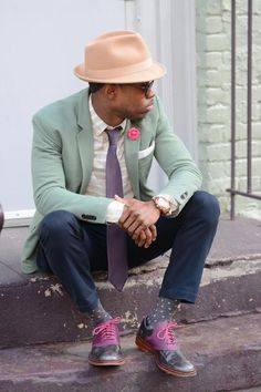 Pairing a mint suit jacket with navy casual trousers is an on-point option for a day in the office. Smarten up your outfit with purple leather oxford shoes. Shop this look on Lookastic: https://lookastic.com/men/looks/blazer-long-sleeve-shirt-chinos/19565 — Beige Wool Hat — Hot Pink Lapel Pin — White Pocket Square — Gold Watch — Violet Tie — Mint Blazer — Grey Horizontal Striped Long Sleeve Shirt — Navy Chinos — Charcoal Polka Dot Socks — Purple Leather Oxford Shoes