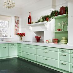 mint and red kitchen (flip the color to the walls and the white to the cabinets) then add white to the mint for the fireplace.