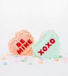 How cute are these DIY conversation heart piñatas?