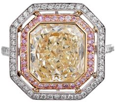 """Double Halo Set 3.99 Ct Yellow Diamond Ring. Ideal non-traditional engagement ring: a 3.99 carat radiant cut fancy yellow diamond, set in 18k yellow gold with a frame of natural pink diamonds, then contained in a halo of white diamonds. The pink diamonds lend a subtle, yet impactful """"pop"""" of color to the center diamond.    In total, the white diamond accent stones weigh .64 carats and the pink .36 carats. Via 1stdibs."""