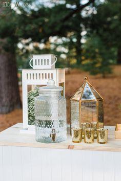 Elegant gold wedding decor   Gold candle holders, clear water jug   GOLD AND EMERALD GREEN WEDDING THEME www.elegantwedding.ca