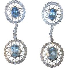 An exceptional pair of estate hand crafted solid 18k white gold fine diamond and earth mined natural aquamarine earrings in mint condition. These