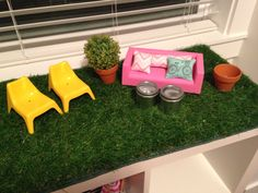 Sage's Dreamhouse. Rooftop grassy patio. Hand made pillows on ikea mini furniture. Tins are from the michael's dollar bin and with battery operated tea lights they look like fire pits! Clay pots also from michael's. Sage leaf studio 2013