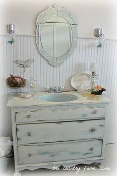 The Country Farm Home: DIY project I am dying to try. turning an old dresser into a sink cabinet (love the color, beadboard, mirror and sconces too)