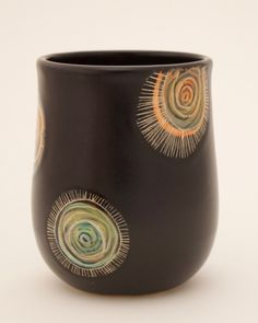 There's a mid-century modern vibe to this accent piece, handmade vessel by Patricia Griffin - ceramic artist in Cambria, CA