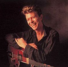 David Bowie smiling, laughing even