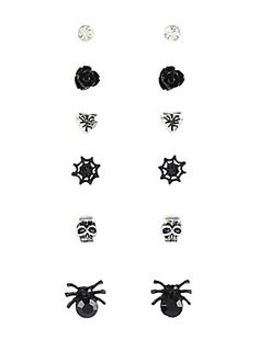 <p>It's totally possible to be spooky and cute at the same time, and these earrings are proof! Blackheart 6 pack post-insertion earrings with black roses, spider webs and gem-body spiders, silver toned skulls, cracked hearts and clear CZ gems. </p>  <ul> 	<li>Alloy</li> 	<li>Imported</li> </ul>