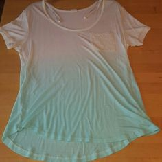 Zumies Ombre shirt Very light weight and comfy. The Ombre is a sky blue, very pretty! It says it's a Large but it fits a little snug for me, especially in the chest area. Other than that it's never been worn, has no holes. Zumies Tops Tees - Short Sleeve