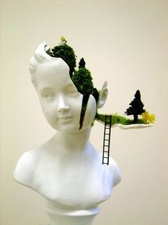 Mixed media artist Gregory Grozos deconstructs a sculptural bust, transforming it into a secret garden for miniature figures. Description from mymodernmet.com. I searched for this on bing.com/images