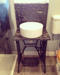 Old singer sewing machine table sink! Upcycling sewing machine table,with granite top...perfect for a bathroom sink!! In love