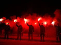 Supporters of Greece's extreme right party Golden Dawn hold flares during a rally to commemorate a 1996 incident which cost the lives of three Greek navy officers and brought Greece and Turkey to the brink of war, in Athens