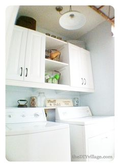 cupboards above the washer and dryer with shelves in between