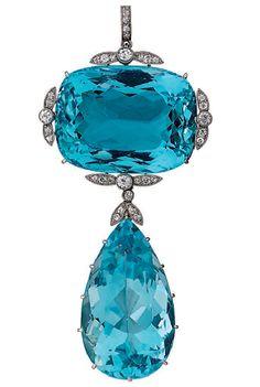 An early 20th century aquamarine and diamond brooch-pendant.
