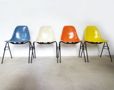 Herman Miller VITRA | Fiberglass Chairs w/ black stacking base | Ray & Charles Eames, 1950