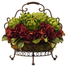 Add natural inspiration to your home office or sunroom with this charming faux artichoke and hydrangea arrangement, nestled in a scrolling footed basket.  ...