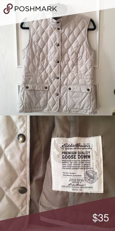 White goose down vest White Eddie Bauer polyester vest with goose down lining. Perfect for fall weather or layering in winter. Well fitted, not puffy. Some discoloration on pockets, but no noticeable stains. Eddie Bauer Jackets & Coats Vests