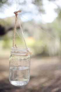 simple out door decorations...you can even put tea lights in these as vintage centerpieces or candlelights. - hang from trees with candles?