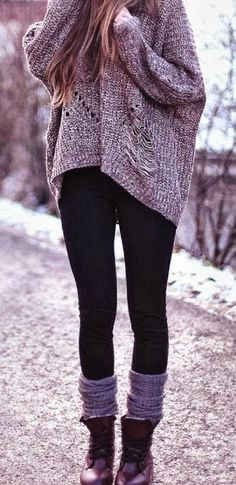 Baggy loose-weave sweater, black leggings, scrunched socks/leg warmers and boots