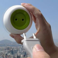 This portable, solar-powered charger, brand named Window Socket, attaches to a window like a leech to a persons skin, and the solar panels on its underbelly charge it up with electricity.