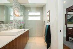 This bathroom is simple and gorgeous. The glass, tile, and marble detailing all make a bold statement. Kihei, HI Coldwell Banker Island Properties $2,850,000