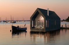 Floating Barn: Modest Houseboat Inspired by Sea Shacks