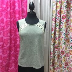 Need a little sporty top? Gray sleeveless knit top with eyelet leather tie detail. 70% cotton 30% rayon