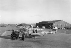 A line of Gloster Meteor F Mark Is and IIIs of No. 616 Squadron RAF is refuelled at Manston, Kent.