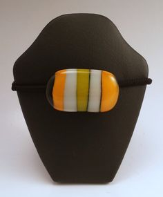 Orange, white and yellow Fused Glass Pony Tail Holder by Lakeside Pottery and Glass. American Made. See the designer's work at the 2016 American Made Show, Washington DC. January 15-17, 2016. americanmadeshow.com #americanmade, #americanmadeshow, #fusedglass, #ponytailholder