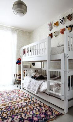 White bunk beds and animal masks