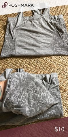 American Eagle performance tee Lightweight and comfy, lace like details on the sides. Excellent condition 🖤 American Eagle Outfitters Tops Tank Tops