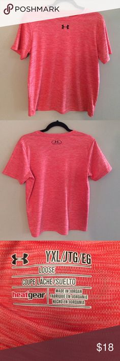 Under Armour top Loose fit. Heat gear top in excellent condition. Dark pink/orange color Under Armour Tops Tees - Short Sleeve